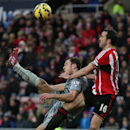 Burnley's Ashley Barnes, left, vies for the ball with Sunderland's captain John O'Shea, right, during their English Premier League soccer match between Sunderland and Burnley at the Stadium of Light, Sunderland, England, Saturday, Jan. 31, 2015