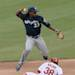 Milwaukee second baseman Rickie Weeks(23) forces out Cardinals' Pete Kozma but is unable to get the double play on John Gast's bunt in the fourth inning during the MLB National League baseball game between the St. Louis Cardinals and the Milwaukee Brewers on Sunday, May 19, 2013, at Busch Stadium in St. Louis