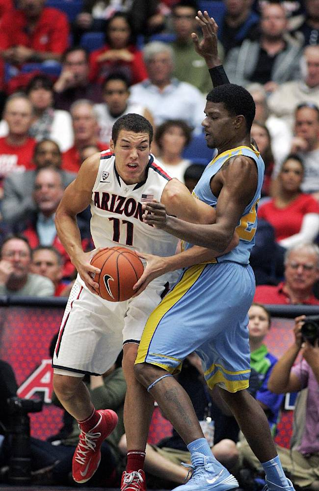 Arizona's Aaron Gordon (11) maneuvers for a shot against the defense of Southern University's Calvin Godfrey during the second half of an NCAA college basketball game Thursday, Dec. 19, 2013, in Tucson, Ariz. Arizona won 69-43