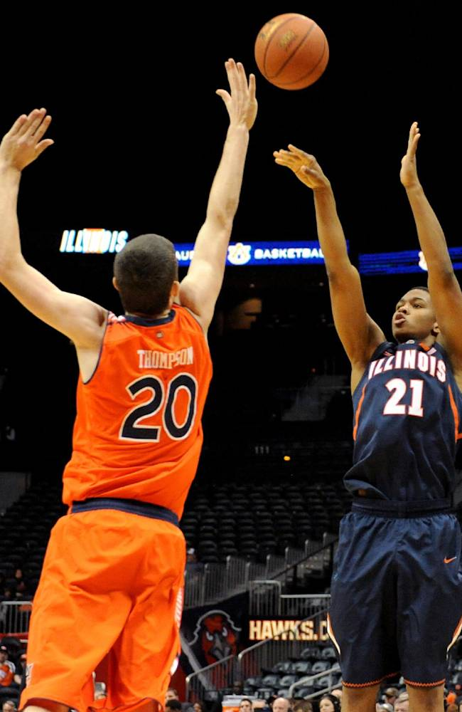 Illinois guard Malcolm Hill (21) shoots a three-point basket over Auburn forward Alex Thompson (20) in the second half of an NCAA college basketball game on Sunday, Dec. 8, 2013, in Atlanta. Illinois won 81-62