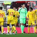 Liverpool's Lazar Markovic, second right, celebrates his goal with his teammates, with Sunderland goalie Costel Pantilimon at centre, during their English Premier League soccer match at the Stadium of Light, Sunderland, England, Saturday, Jan. 10, 2015