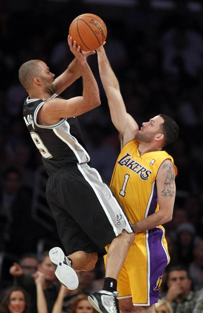 San Antonio Spurs guard Tony Parker, left, of France, shoots over Los Angeles Lakers guard Jordan Farmar during the second quarter of an NBA basketball game Friday, Nov. 1, 2013, in Los Angeles