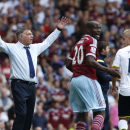 West Ham United's manager Sam Allardyce, left, raises his hands reacting to a referee decision during their English Premier League soccer match against Tottenham Hotspur at Upton Park, London, Saturday, Aug. 16, 2014