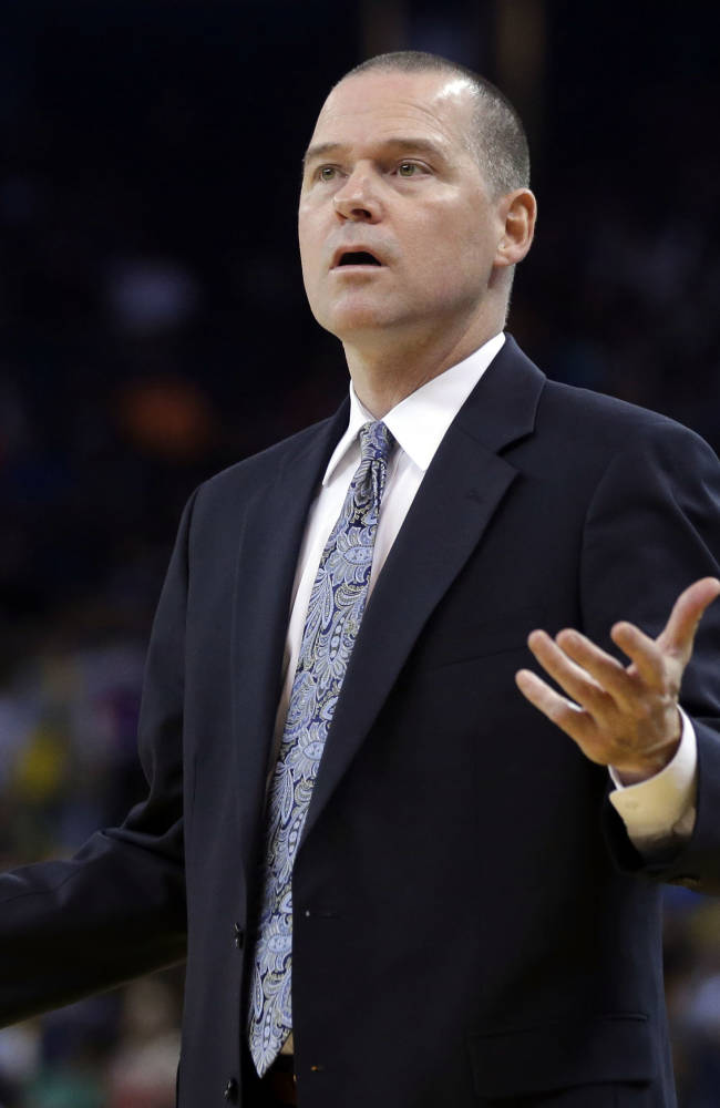 Sacramento Kings cooach Michael Malone questions a call as his team plays the Golden State Warriors during the first half of an NBA preseason basketball game on Monday, Oct. 7, 2013, in Oakland, Calif
