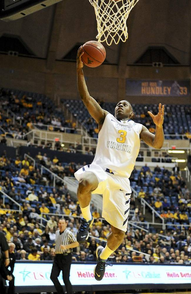 West Virginia's Juwan Staten drives the lane during the second half of an NCAA college basketball game against Mount St. Mary's in Morgantown, W.Va., Friday, Nov. 8, 2013. West Virginia won 77-62