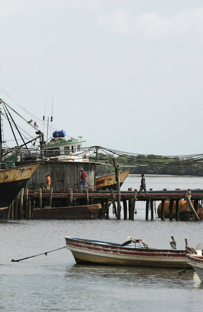 In this Sept. 3, 2013 photo, boats are anchored in Puerto Caimito, the home town of New York Yankee pitcher Mariano Rivera, in Panama.  Rivera was probably destined for a life as a fisherman until his uncle Miguel Rivera died from a mishap at sea.  The tragedy convinced him to concentrate on baseball rather than the risky life of a fisherman. Rivera signed with the Yankees two years after the death of his uncle
