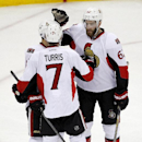 Ottawa Senators players, Kyle Turris (7), Eric Gryba (62) and Clarke MacArthur (16), celebrate a goal by Turris against the New Jersey Devils during the third period of an NHL hockey game, Wednesday, Dec. 17, 2014, in Newark, N.J. The Senators won 2-0 Th