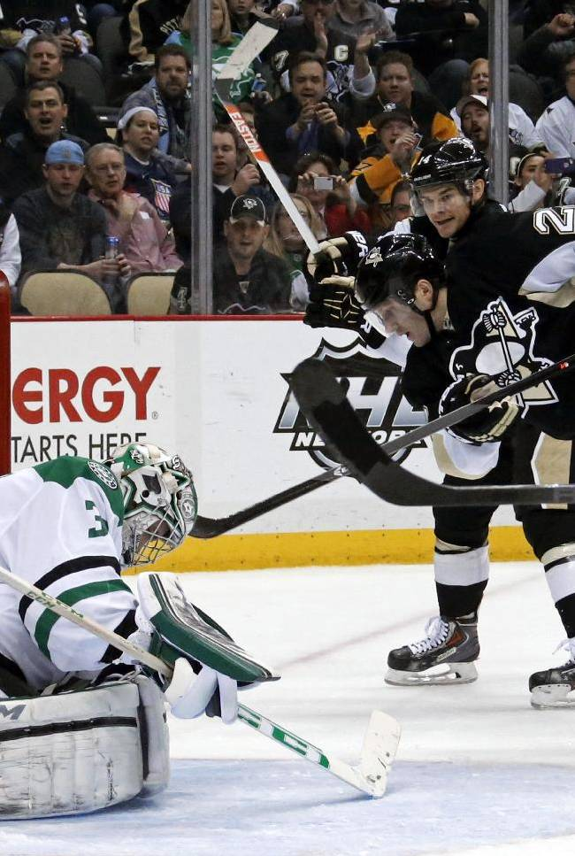 Pittsburgh Penguins' Lee Stempniak (22) leaves his skates as he puts the puck behind Dallas Stars goalie Kari Lehtonen (32) for a goal in the second period of an NHL hockey game in Pittsburgh, Tuesday, March 18, 2014