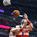 Chicago Bulls guard Kirk Hinrich, left, fouls Washington Wizards center Marcin Gortat during the first half of Game 2 in an opening-round NBA basketball playoff series game Tuesday, April 22, 2014, in Chicago The Associated Press