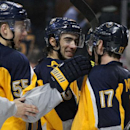 Buffalo Sabres' Rasmus Ristolainen (55), of Finland, Matt Moulson (26) and Torrey Mitchell (17) celebrate their 2-1 victory over the Tampa Bay Lightning following an NHL hockey game Tuesday, Dec. 2, 2014, in Buffalo, N.Y The Associated Press