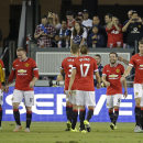 Manchester United forward Juan Mata (8) is greeted by his teammates after scoring a goal during the first half of an International Champions Cup soccer match against the San Jose Earthquakes on Tuesday, July 21, 2015, in San Jose, Calif. (AP Photo/Eric Ri