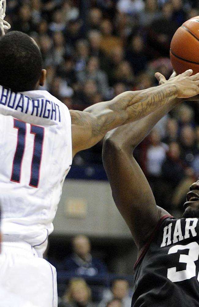 Connecticut's Ryan Boatright (11) guards Harvard's Kyle Casey (30)during the first half of an NCAA college basketball game in Storrs, Conn., Wednesday, Jan. 8, 2014