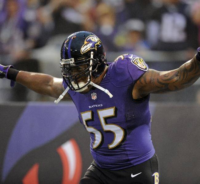 Baltimore Ravens outside linebacker Terrell Suggs runs onto the field as he is introduced before an NFL football game against the New England Patriots, Sunday, Dec. 22, 2013, in Baltimore