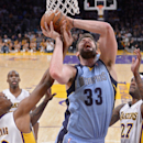 Memphis Grizzlies center Marc Gasol, center, of Spain, puts up a shot as Los Angeles Lakers forward Nick Young, left, and forward Jordan Hill defend during the first half of an NBA basketball game, Sunday, April 13, 2014, in Los Angeles The Associated Pre