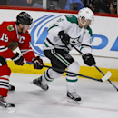 Dallas Stars center Vernon Fiddler (38) keeps the puck away from Chicago Blackhawks center Jonathan Toews (19) during the third period of an NHL hockey game in Chicago, Sunday, Jan. 18, 2015. The Stars won 6-3 The Associated Press