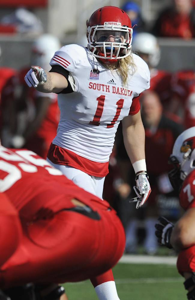 In this Oct. 26, 2013 file photo, South Dakota linebacker Tyler Starr (11) yells to teammates during an NCAA football game against Illinois State in Normal, Ill. The Atlanta Falcons chose Starr with the 255th pick in the NFL draft, the second-to-last player chosen. Starr issued a statement saying he can't wait to get his pro career started
