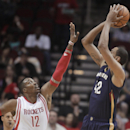 Houston Rockets center Dwight Howard (12) defends New Orleans Pelicans center Alexis Ajinca during the first quarter of an NBA basketball game, Saturday, April 12, 2014, in Houston The Associated Press
