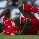 Liverpool's Mario Balotelli gestures in pain during their English Premier League soccer match against Tottenham Hotspur, at White Hart Lane, London, Sunday, Aug. 31, 2014