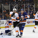 Philadelphia Flyers center Vincent Lecavalier (40) and center Chris Vande Velde (76), right, celebrate his goal as New York Islanders goalie Jaroslav Halak (41) and defenseman Travis Hamonic (3) in the third period of an NHL hockey game at Nassau Coliseum