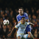 Chelsea's Frank Lampard, background, competes with Steaua Bucharest's Leandro Tatu during their Champions League group E soccer match at Stamford Bridge, London, Wednesday, Dec. 11, 2013