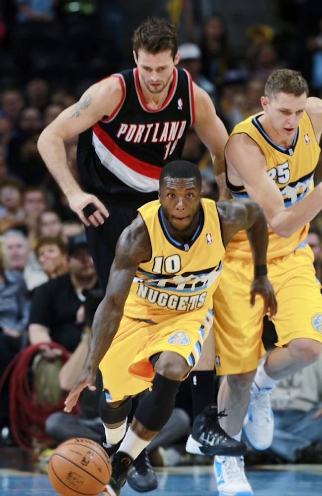 Denver Nuggets guard Nate Robinson, front, picks up a loose ball and heads down court with Portland Trail Blazers forward Joel Freeland, back left, of England, and Nuggets center Timofey Mozgov, of Russia, in pursuit in the fourth quarter of Portland's 113-98 victory in an NBA basketball game in Denver on Friday, Nov. 1, 2013