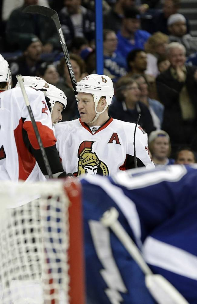 Ottawa Senators right wing Chris Neil (25, right) celebrates his goal against the Tampa Bay Lightning with teammates including Jared Cowen (2) and Colin Greening (14) during the third period of an NHL hockey game Thursday, Jan. 23, 2014, in Tampa, Fla. the Lightning won the game 4-3 in a shootout