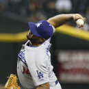 Los Angeles Dodgers' Kenley Jansen delivers a pitch against the Arizona Diamondbacks during the ninth inning of a baseball game on Sunday, April 13, 2014, in Phoenix. The Dodgers defeated the Diamondbacks 8-6 The Associated Press