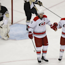 Carolina Hurricanes' Eric Staal (12) celebrates with teammates Andrei Loktionov (8), of Russia, and Chris Terry (58) after deflecting a shot past Pittsburgh Penguins goalie Marc-Andre Fleury (29) for a goal during the third period of an NHL hockey game on