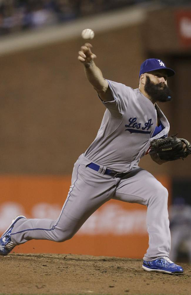 Los Angeles Dodgers pitcher Brian Wilson throws against the San Francisco Giants during the eighth inning of a baseball game in San Francisco, Tuesday, Sept. 24, 2013