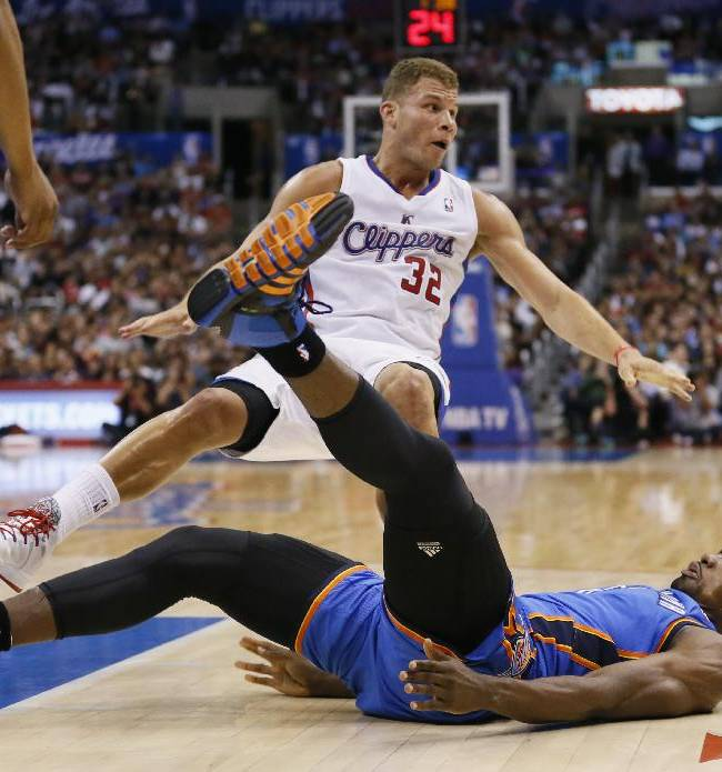 Los Angeles Clippers forward Blake Griffin, rear, is called for a foul on Oklahoma City Thunder forward Serge Ibaka as they fall to the court during the first half of an NBA basketball game in Los Angeles, Wednesday, April 9, 2014
