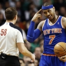 New York Knicks' Carmelo Anthony points to his headband after he was fouled during the fourth quarter of an NBA basketball game against the Boston Celtics in Boston, Tuesday, March 26, 2013. The Knicks won 100-85. (AP Photo/Winslow Townson)