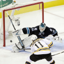 Boston Bruins center Gregory Campbell (11) scores past San Jose Sharks goalie Antti Niemi, of Finland, during the first period of an NHL hockey game Thursday, Dec. 4, 2014, in San Jose, Calif The Associated Press