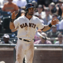 San Francisco Giants' Angel Pagan celebrates after scoring on Pablo Sandoval's base hit during the third inning of a baseball game against the Arizona Diamondbacks in San Francisco, Thursday, Sept. 11, 2014. The Giants won 6-2. The Associated Press