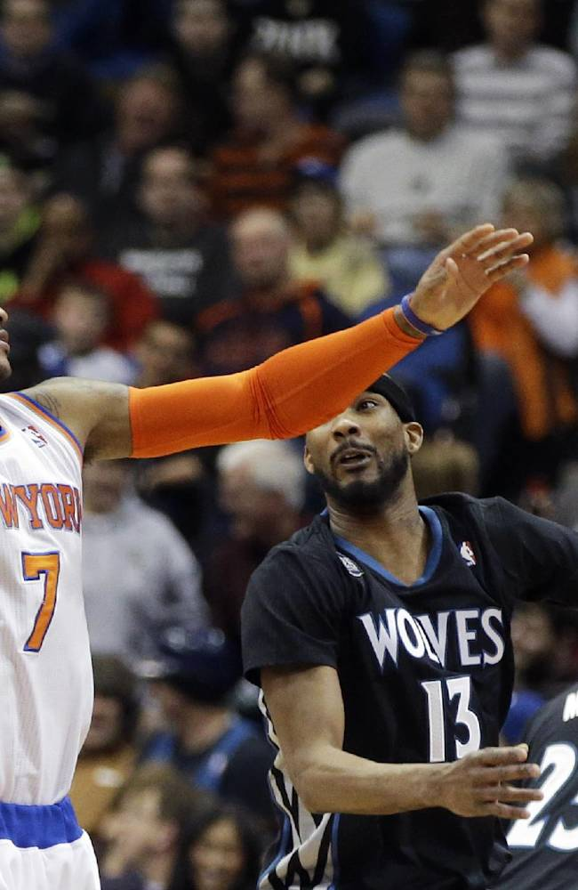 New York Knicks' Carmelo Anthony, left, beats Minnesota Timberwolves' Corey Brewer to a pass in the first quarter of an NBA basketball game, Wednesday, March 5, 2014, in Minneapolis