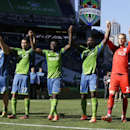 Seattle Sounders, including Obafemi Martins (9) and goalkeeper Stefan Frei, second from right, celebrate after they beat Chivas USA 4-2 in an MLS soccer match, Saturday, Sept. 27, 2014, in Seattle. The Associated Press