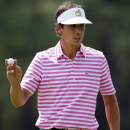Amateur Kelly Kraft holds up his ball after putting on the 14th green during the first round of the Masters golf tournament Thursday, April 5, 2012, in Augusta, Ga. (AP Photo/Chris O'Meara)