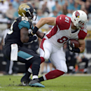 Arizona Cardinals tight end Jim Dray (81) is tackled by Jacksonville Jaguars outside linebacker Geno Hayes (55) after a reception during the first half of an NFL football game in Jacksonville, Fla., Sunday, Nov. 17, 2013 The Associated Press