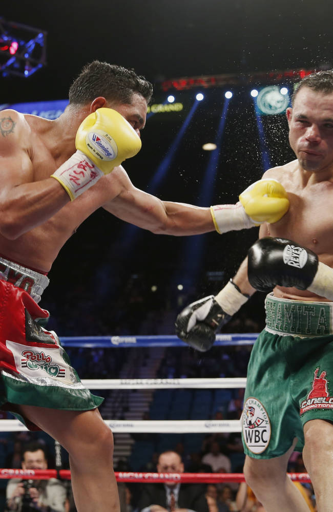 Alvarez rebounds by stopping Angulo in 10th