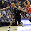 Brooklyn Nets guard Joe Johnson, center, drives to the basket between Chicago Bulls center Joakim Noah, right, and guard Jimmy Butler during the first half of an NBA basketball game in Chicago on Thursday, Feb. 13, 2014 The Associated Press