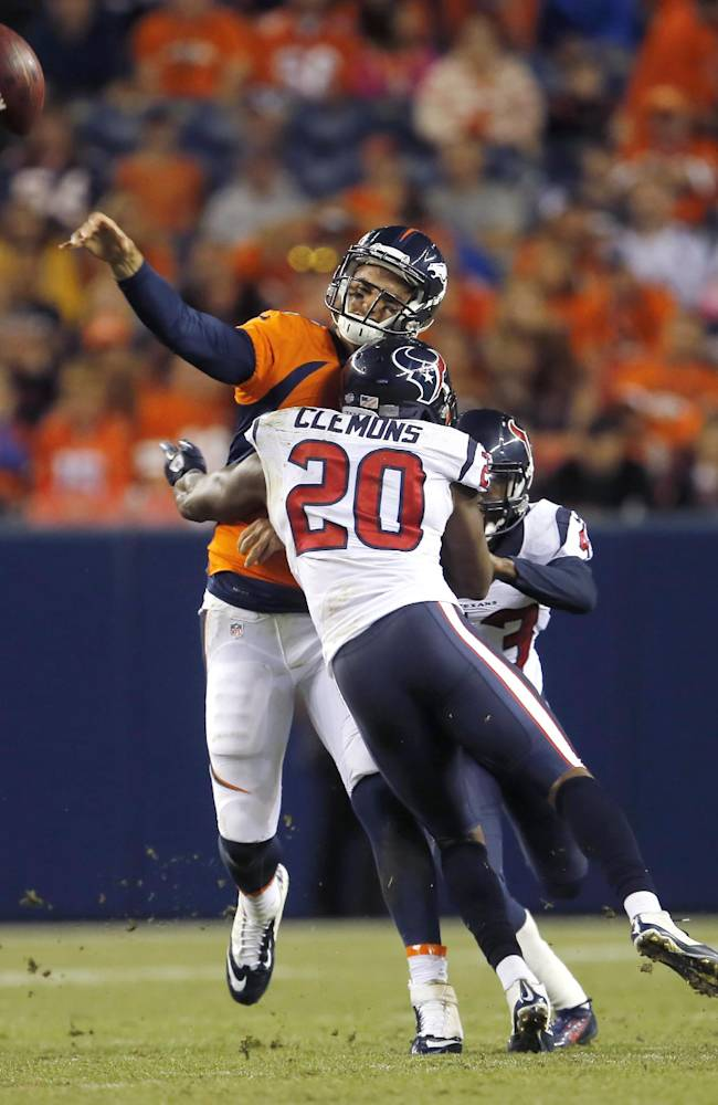Denver Broncos quarterback Brock Osweiler (17) gets hit by Houston Texans strong safety Chris Clemons (20) during the second half of an NFL preseason football game, Saturday, Aug. 23, 2014, in Denver