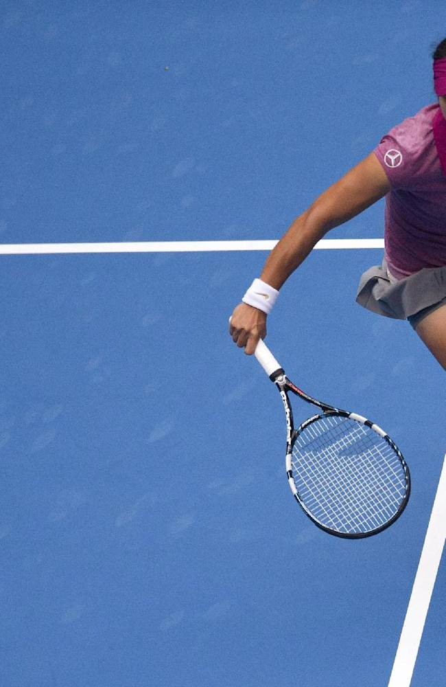 Li Na of China returns a shot to Petra Kvitova of the Czech Republic during the quarterfinal match in China Open tennis tournament at the National Tennis Stadium in Beijing, China Friday, Oct. 4, 2013