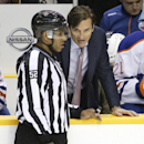 Edmonton Oilers head coach Dallas Eakins talks to an official in the third period of an NHL hockey game against the Nashville Predators Thursday, Nov. 27, 2014, in Nashville, Tenn. The Predators won 1-0 in overtime The Associated Press
