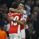 Arsenal's Alexis Sanchez, right, celebrates with teammate Santi Cazorla after scoring a goal during a second leg Champions League qualifying soccer match between Arsenal and Besiktas at Emirates Stadium in London Wednesday, Aug. 27, 2014.(AP Photo/Kirsty