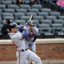 Atlanta Braves' Dan Uggla breaks his bat as he hits an RBI-single off of New York Mets relief pitcher Brandon Lyon in the tenth inning of a baseball game that was suspended from Friday night at Citi Field, Saturday, May 25, 2013 in New York. The Braves won 7-5. (AP Photo/Kathy Kmonicek)