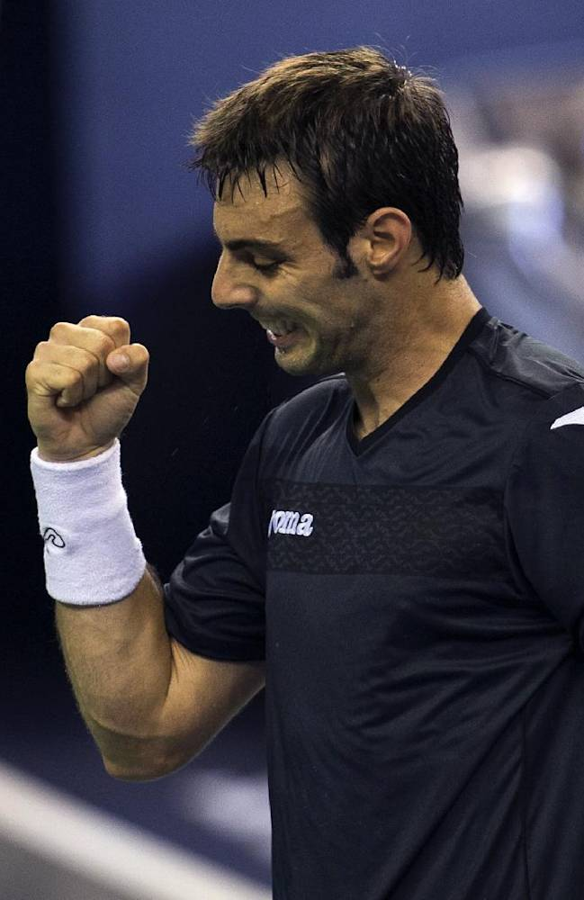 Spain's Marcel Granollers celebrates after defeating Serbia's Janko Tipsarevic during a match at the Shanghai Masters Tennis tournament held in the Qi Zhong Tennis Center in Shanghai, China on Monday, Oct. 7, 2013. Granollers won 6-4, 6-4
