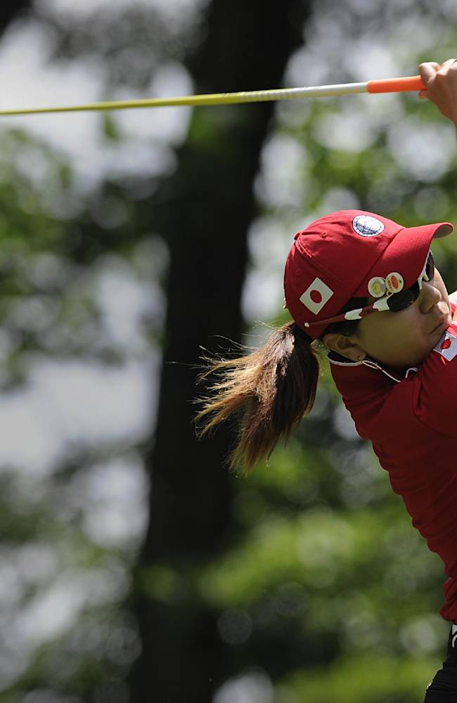 Mika Miyazato, of Japan, drives from the fifth hole during the final round of the International Crown golf tournament Sunday, July 27, 2014, in Owings Mills, Md