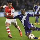Arsenal's Alexis Sanchez, left, and Anderlecht's Gohi Bi Zoro Cyriac vie for the ball during the Group D Champions League match between Anderlecht and Arsenal at Constant Vanden Stock Stadium in Brussels, Belgium, Wednesday Oct. 22, 2014