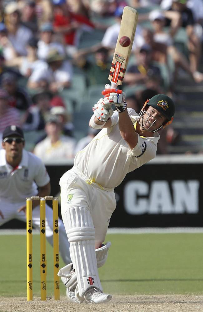 Australia's David Warner drives during the second Ashes cricket test match against England in Adelaide, Australia, Saturday, Dec. 7, 2013