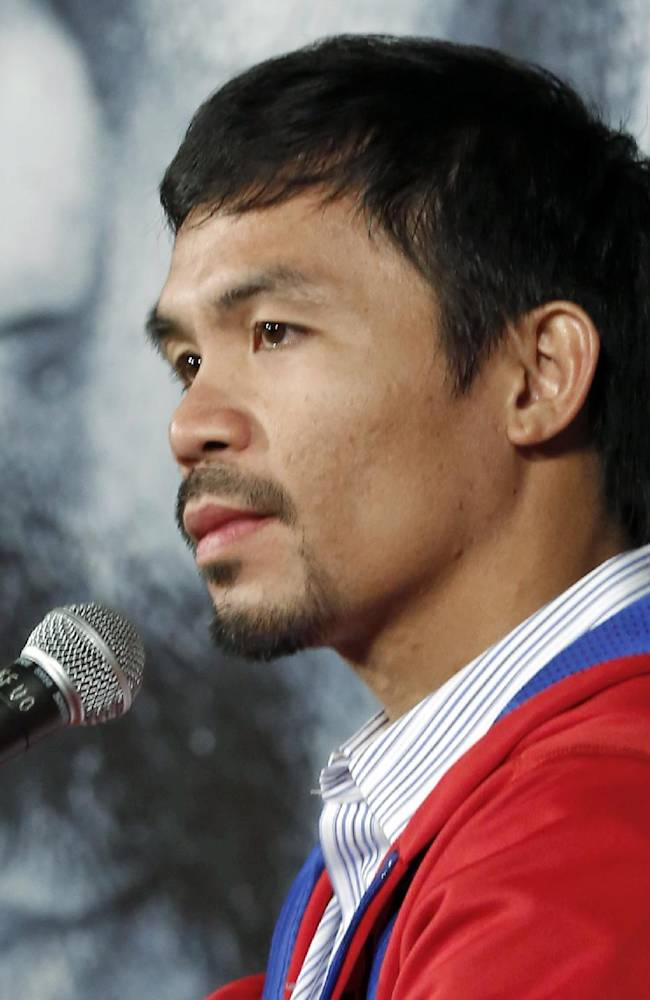 Manny Pacquiao, of the Philippines, speaks at a news conference in Beverly Hills, Calif., Tuesday, Feb. 4, 2014, to promote his upcoming WBO welterweight championship boxing rematch against Tim Bradley. Pacquiao and Bradley's first match on June 9, 2012, was a split decision in favor of Bradley, which ended Pacquiao's welterweight title reign as well as his seven-year, 15-bout winning streak.  Pacquiao vs. Bradley 2 will take place Saturday, April 12, 2014, in Las Vegas