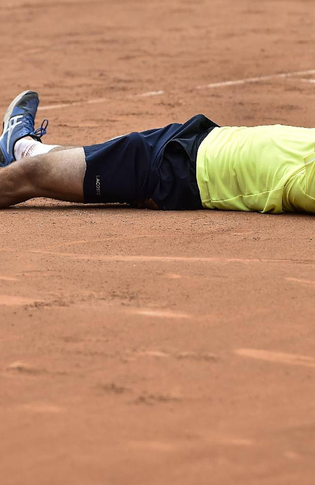 Pablo Andujar of Spain, celebrates his victory against Juan Monaco of Argentina after the final match at the Swiss Open tennis tournament in Gstaad, Switzerland, Sunday, July 27, 2014